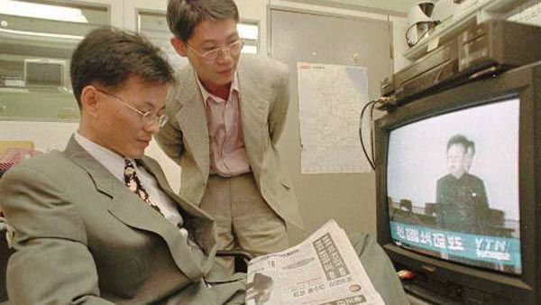 Two South Korean businessmen watch television broadcasting the news of Kim Jong Il&#39;s election to general secretary of North Korea&#39;s Workers Party, at the their office in Seoul, Wednesday, Oct. 8, 1997. Kim Jong Il, North Korea&#39;s undisputed leader for the last three years, was formally named head of the ruling party Wednesday, taking on one of the titles left vacant when his father died in 1994. &#40;AP Photo&#47;Ahn Young-joon&#41; <span class=meta>(AP Photo&#47; AHN YOUNG-JOON)</span>