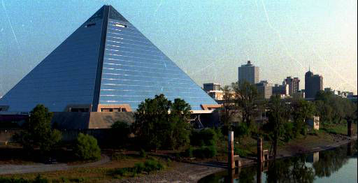 The Memphis Pyramid, a sports and entertainment arena, sits beside a harbor leading to the Mississippi River Wednesday, Oct. 22, 1997. In background is part of downtown Memphis, Tenn., skyline. &#40;AP Photo&#47;Jake Herrle&#41; <span class=meta>(AP Photo&#47; JAKE HERRLE)</span>