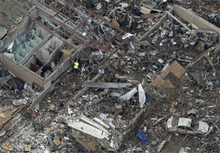An aerial view shows Tower Plazas Elementary school in Moore, Okla., Tuesday, May 21, 2013 as rescue workers make their way through the structure. At least 24 people, including nine children, were killed in the massive tornado that flattened homes and a school in Moore, on Monday afternoon.  <span class=meta>(AP Photo&#47; Tony Gutierrez)</span>