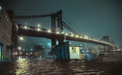 Streets are flooded under the Manhattan Bridge in the Dumbo section of Brooklyn, N.Y., Monday, Oct. 29, 2012. Sandy continued on its path Monday, as the storm forced the shutdown of mass transit, schools and financial markets, sending coastal residents fleeing, and threatening a dangerous mix of high winds and soaking rain. &#40;AP Photo&#47;Bebeto Matthews&#41; <span class=meta>(AP Photo&#47; Bebeto Matthews)</span>