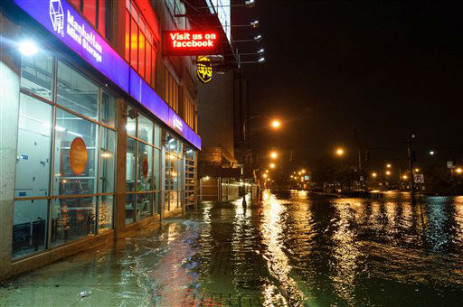"<div class=""meta ""><span class=""caption-text "">This photo provided by Dylan Patrick shows flooding along the Westside Highway near the USS Intrepid as Sandy moves through the area Monday, Oct. 29, 2012 in New York. Much of New York was plunged into darkness Monday by a superstorm that overflowed the city's historic waterfront, flooded the financial district and subway tunnels and cut power to nearly a million people. (AP Photo/Dylan Patrick) MANDATORY CREDIT: DYLAN PATRICK (AP Photo/ Dylan Patrick)</span></div>"