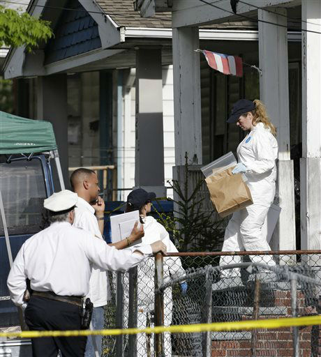 Members of the FBI evidence response team carry out evidence from a house Tuesday, May 7, 2013, where three women who vanished a decade ago were held, in Cleveland. The women were found safe Monday, and police arrested three brothers accused of holding the victims against their will.   <span class=meta>(AP Photo&#47; Tony Dejak)</span>