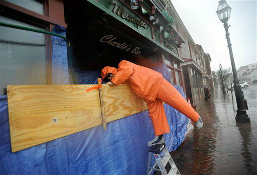 Charlie Priola, owner of Mangia&#39;s restaurant in Annapolis, Md., tries to protect his restaurant from Hurricane Sandy, Monday, Oct. 29, 2012. Hurricane Sandy continued on its path Monday, as the storm forced the shutdown of mass transit, schools and financial markets, sending coastal residents fleeing, and threatening a dangerous mix of high winds and soaking rain. &#40;AP Photo&#47;Steve Ruark&#41; <span class=meta>(AP Photo&#47; Steve Ruark)</span>