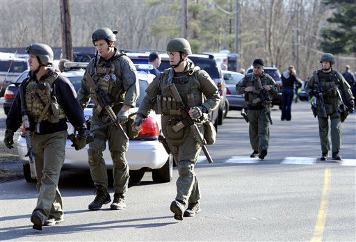 "<div class=""meta ""><span class=""caption-text "">State Police are on scene following a shooting at the Sandy Hook Elementary School in Newtown, Conn., about 60 miles (96 kilometers) northeast of New York City, Friday, Dec. 14, 2012. An official with knowledge of Friday's shooting said 27 people were dead, including 18 children.  (AP Photo/ Jessica Hill)</span></div>"