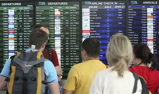 "<div class=""meta ""><span class=""caption-text "">Travelers look at the departures and arrivals board after Asiana Flight 214 crashed at San Francisco International Airport in San Francisco, Saturday, July 6, 2013. An Asiana Airlines flight from Seoul, South Korea, crashed while landing at San Francisco International Airport on Saturday, forcing passengers to jump down the emergency inflatable slides to safety. There were early reports of injuries, but the extent wasn't immediately clear.   (AP Photo/ Darryl Bush)</span></div>"