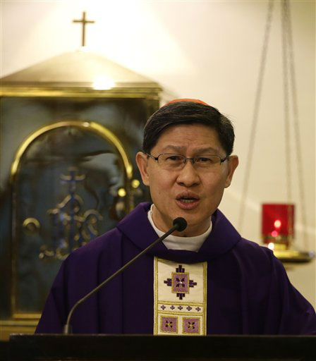 Manila Archbishop Luis Antonio Cardinal Tagle delivers his homily during a mass at the Arzobizpado Chapel on Ash Wednesday Feb. 13, 2013 in Manila, Philippines. Cardinal Tagle is the only Filipino cardinal who can vote and be voted to succeed Pope Benedict XVI who resigned last week. &#40;AP Photo&#47;Bullit Marquez&#41; <span class=meta>(AP Photo&#47; Bullit Marquez)</span>