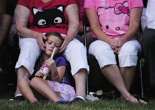 "<div class=""meta ""><span class=""caption-text "">Family members of the victims of the Century 16 theater shooting remember their loved ones during a vigil at the Aurora Municipal Center campus in Aurora, Colo. Sunday, July 22, 2012. 12 people were killed and 58 were injured in a shooting during an early Friday premiere of ?The Dark Knight Rises."" (AP Photo/The Denver Post, AAron Ontiveroz, Pool) (AP Photo/ AAron Ontiveroz)</span></div>"