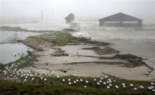 "<div class=""meta ""><span class=""caption-text "">Sea birds surround the American Legion fishing pier in Bay St. Louis, Miss., as Isaac's winds and storm surge flood some low laying neighborhoods, Wednesday, Aug. 29, 2012, the seventh  anniversary of Hurricane Katrina hitting the Gulf Coast. Isaac was packing 80 mph winds, making it a Category 1 hurricane. It came ashore early Tuesday near the mouth of the Mississippi River, driving a wall of water nearly 11 feet high inland and soaking a neck of land that stretches into the Gulf.  (AP Photo/ Rogelio V. Solis)</span></div>"