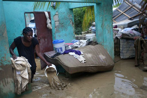 Finanette Guerrier 29, bails muddy water from her flooded house after the passing of Tropical Storm Isaac in Port-au-Prince, Haiti, Sunday Aug. 26, 2012. The death toll in Haiti from Tropical Storm Isaac has climbed to seven after an initial report of four deaths, the Haitian government said Sunday. <span class=meta>(AP Photo&#47; Dieu Nalio Chery)</span>