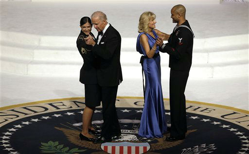 "<div class=""meta ""><span class=""caption-text "">Vice President Joe Biden dances with Army Staff Sgt. Keesha Dentino as Jill Biden dances with Navy Petty Officer 3rd Class Patrick Figueroa during the Commander-In-Chief inaugural ball at the Washington Convention Center during the 57th Presidential Inauguration Monday, Jan. 21, 2013 in Washington.  (AP Photo/ Evan Vucci) (AP Photo/ Evan Vucci)</span></div>"