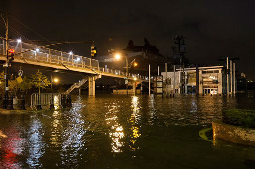 "<div class=""meta image-caption""><div class=""origin-logo origin-image ""><span></span></div><span class=""caption-text"">This photo provided by Dylan Patrick shows flooding along the Westside Highway near the USS Intrepid, background center, as Sandy moves through the area Monday, Oct. 29, 2012 in New York. Much of New York was plunged into darkness Monday by a superstorm that overflowed the city's historic waterfront, flooded the financial district and subway tunnels and cut power to nearly a million people. (AP Photo/ Dylan Patrick)</span></div>"