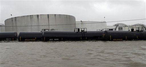 Railcars sit in floodwaters next to a chemical plant as Hurricane Isaac hits Wednesday, Aug. 29, 2012, in Braithwaite, La.   <span class=meta>(AP Photo&#47; David J. Phillip)</span>