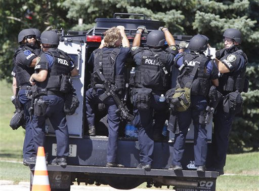 Police personnel move outside the Sikh Temple in Oak Creek, Wis, where a shooting took place Sunday, Aug. 5, 2012.   <span class=meta>(AP Photo&#47; JEFFREY PHELPS)</span>