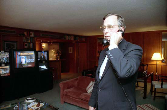President Bush talks on the telephone while watching election results on November 3, 1992.  Photos provided by: George Bush Presidential Library and Museum