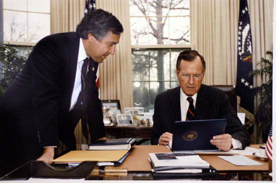 David Valdez in the Oval Office showing President Bush photos.  Photos provided by: George Bush Presidential Library and Museum