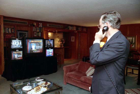 President Bush gives talks on the telephone while watching election results on November 3, 1992.   Photos provided by: George Bush Presidential Library and Museum