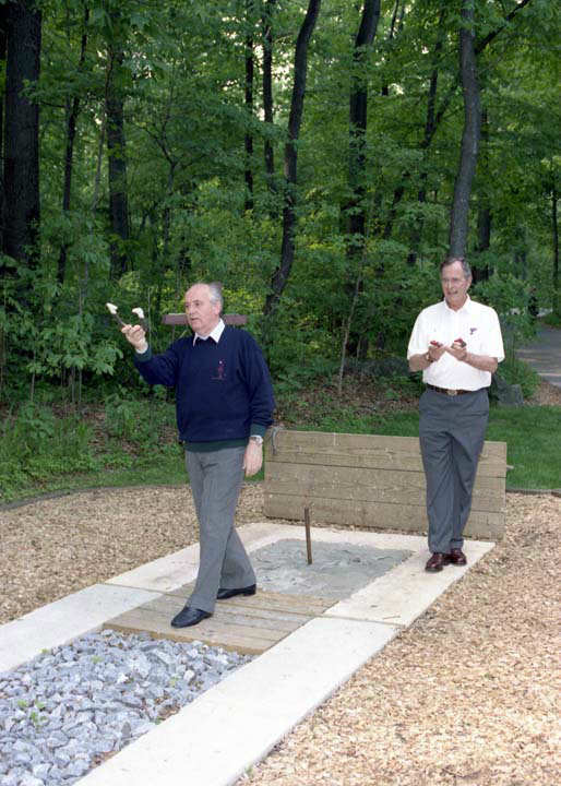 Presidents Bush and Gorbachev pitch horseshoes at Camp David on June 2, 1990.   Photos provided by: George Bush Presidential Library and Museum