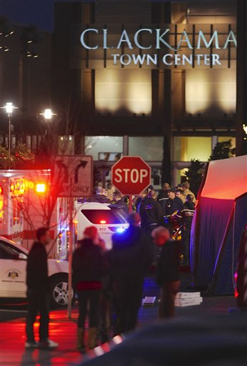 "<div class=""meta ""><span class=""caption-text "">Police and medics outside the scene of a multiple shooting at Clackamas Town Center Mall in Clackamas, Ore., Tuesday Dec. 11, 2012. A gunman is dead after opening fire in the Portland, Ore., area shopping mall Tuesday, killing two people and wounding another, sheriff's deputies said. (AP Photo/Greg Wahl-Stephens)</span></div>"