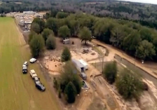 This image taken from video and released by RickeyStokesNews.com, on Tuesday, Feb. 5, 2013 shows an aerial view of the compound owned by 65-year-old Jimmy Lee Dykes. A 5-year-old boy is safe after being held by Dykes for a week in a closet-sized bunker on the compound. The boy was rescued and his captor is dead after federal agents raided the bunker on Monday. The precise location of the bunker is unknown.   <span class=meta>(AP Photo&#47;Rickey Stokes)</span>
