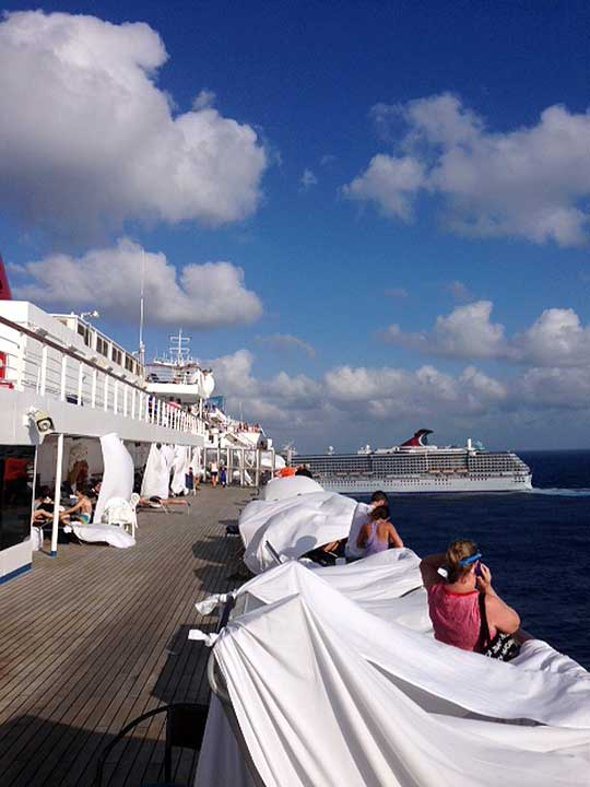 "<div class=""meta ""><span class=""caption-text "">This Sunday, Feb. 10, 2013 photo, provided by Kalin Hill, of Houston, shows passengers with makeshift tents on the the deck of the Carnival Triumph cruise ship at sea in the Gulf of Mexico. The ship nearing Mobile Bay is without engine power and is being towed by tugboats. (AP Photo/Kalin Hill)</span></div>"