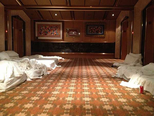Makeshift beds and linens line the hallways inside the Carnival cruise ship Triumph
