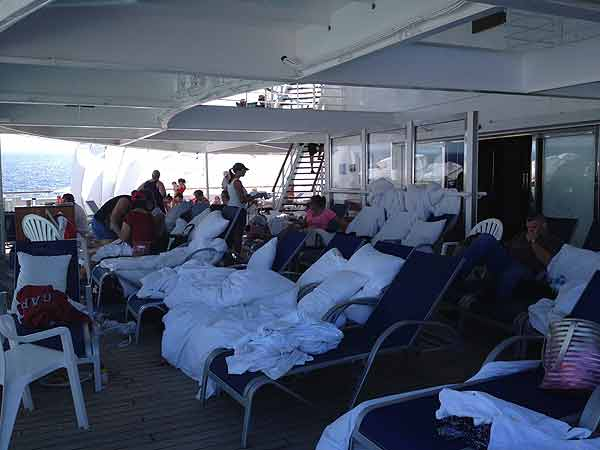"<div class=""meta image-caption""><div class=""origin-logo origin-image ""><span></span></div><span class=""caption-text"">Passengers do whatever they can to pass the time on board the disabled Carnival cruise ship</span></div>"