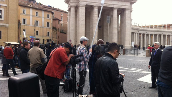 "<div class=""meta ""><span class=""caption-text "">Tom Koch in the madness of the papal conclave media coverage. (Photo/Weny Granato)</span></div>"
