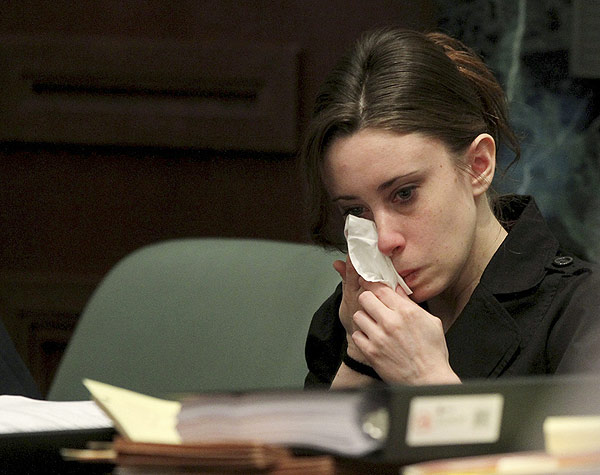 Casey Anthony listens to the testimony of Mallory Parker during Anthony's trial at the Orange County Courthouse, Friday, May 27, 2011 in Orlando, Fla. Anthony, 25, has pleaded not guilty to first-degree murder of her daughter, 2-year-old Caylee Anthony, in the summer of 2008. If convicted, she could be sentenced to death. (AP Photo/Red Huber, Pool)