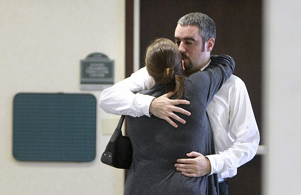 Lee Anthony, brother of Casey Anthony, hugs his fiance, Mallory Parker after she testified during day 4 of the trial at the Orange County Courthouse, in Orlando, Fla., Friday, May 27, 2011. Casey Anthony has pleaded not guilty to first-degree murder of her daughter, 2-year-old Caylee Anthony in the summer of 2008. If convicted, she could be sentenced to death. (AP Photo/Joe Burbank, Pool)