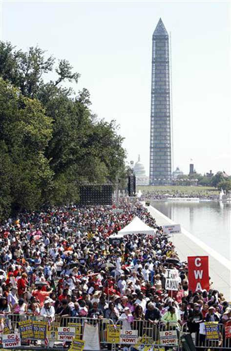 People line the reflecting pool as they listen to speakers at a rally to commemorate the 50th anniversary of the 1963 March on Washington on Saturday, Aug. 24, 2013, in Washington. In the background are the U.S. Capitol and the Washington Monument. &#40;AP Photo&#47;Jon Elswick&#41; <span class=meta>(Photo&#47;Jon Elswick)</span>