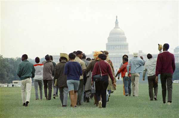 "<div class=""meta ""><span class=""caption-text "">A crowd gathers on the National Mall in front of the Capitol area to demonstrate for the civil rights movement in Washington, D.C., on August 28, 1963.  (AP Photo)</span></div>"