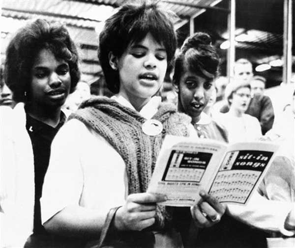 Standing singers of sit-in songs at the New Haven bus terminal on August 28, 1963 just before their departure for Washington, D.C. to take part in the civil rights march. The songbook was furnished by the Congress of Racial Equality, with co-sponsored the Connecticut contingent of over 3,000 with the National Association for the Advancement of Colored People. &#40;AP Photo&#47;Bob Child&#41; <span class=meta>(Photo&#47;Bob Child)</span>