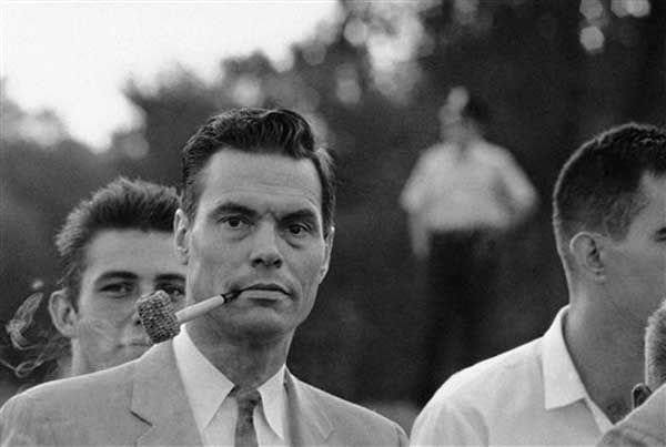 George Lincoln Rockwell, leader of the Anti-Negro Anti-Jew American Nazi Party, puffs on a corncob pipe as he poses at the Washington Monument, August 28, 1963, Rockwell and about 40 of his followers showed up without customary uniforms in the monument grounds, center of the March on Washington activities. Police denied a parade permit for Rockwell. (AP Photo)