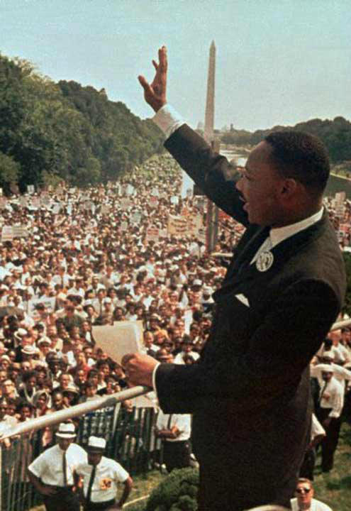 "FOR USE ANYTIME - Dr. Martin Luther King Jr. acknowledges the crowd at the Lincoln Memorial for his ""I Have a Dream"" speech during the March on Washington, D.C. Aug. 28, 1963.  Thursday April 4, 1996 will mark the 28th anniversary of his assassination in Memphis, Tenn. The Washington Monument is in background. (AP Photo/File)"