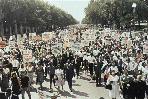 "<div class=""meta ""><span class=""caption-text "">Large crowds gather at the Washington Monument to demonstrate for the civil rights movement in Washington, D.C., on August 28, 1963. (AP Photo)</span></div>"