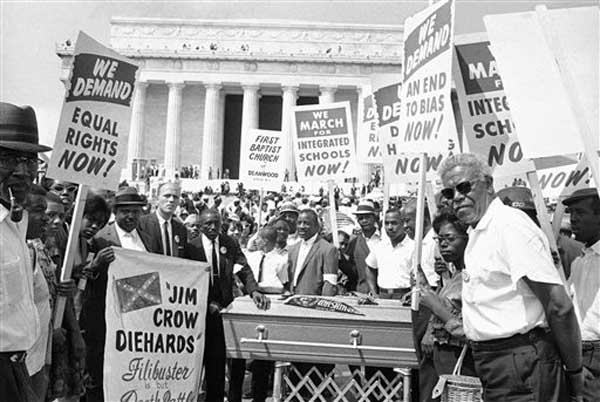 "<div class=""meta ""><span class=""caption-text "">Group of demonstrators stand around casket at Lincoln Memorial in Washington, August 28, 1963. The group carried placards as they pushed the casket down Constitution Avenue during the March on Washington parade. (AP Photo) (Photo/Anonymous)</span></div>"