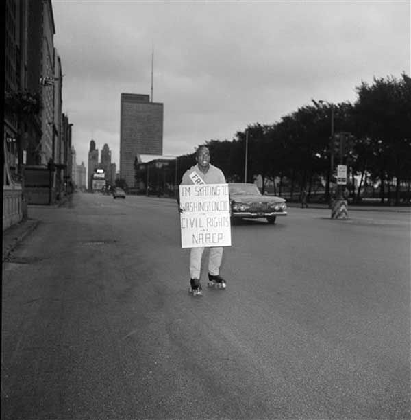 Carrying a placard telling of his mission, Ledger Smith, 27, starts down Michigan Ave. in Chicago on a roller skating journey to Washington, D.C., Aug. 17, 1963. He hopes to skate the 685 miles to the capital by Aug. 27 to join the civil rights march there on Aug. 28. Smith was followed by an automobile carrying friends of the NAACP, and spare skates. &#40;AP Photo&#47;Harry L. Hall&#41; <span class=meta>(Photo&#47;Harry L. Hall)</span>