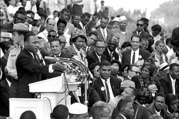 "<div class=""meta ""><span class=""caption-text "">FILE - In this Aug. 28, 1963 file photo, the Rev. Dr. Martin Luther King Jr., head of the Southern Christian Leadership Conference, speaks to thousands during his ""I Have a Dream"" speech in front of the Lincoln Memorial for the March on Washington for Jobs and Freedom, in Washington. Actor-singer Sammy Davis Jr., is at bottom right. It has been cited as one of America's essential ideals, its language suggestive of a constitutional amendment on equality: People should ""not be judged by the color of their skin but by the content of their character."" Yet 50 years after the King's monumental statement, there is considerable disagreement over what this quote means when it comes to affirmative action and other measures aimed at helping the disadvantaged. (AP Photo/File)</span></div>"