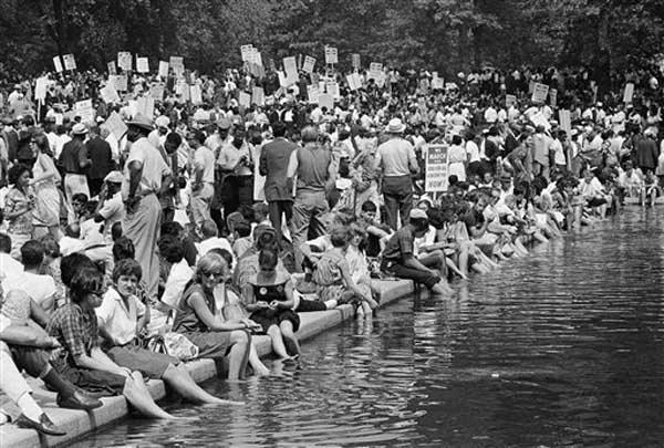 "<div class=""meta ""><span class=""caption-text "">A crowd gathers near the reflecting pooll in Washington, Aug. 28, 1963, to hear speakers in ceremonies following the March on Washington parade through the Capitol streets. (AP Photo) (Photo/Anonymous)</span></div>"