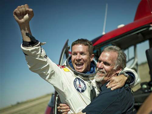 In this photo provided by Red Bull Stratos, pilot Felix Baumgartner of Austria and Technical Project Director Art Thompson, celebrate after successfully completing the final manned flight for Red Bull Stratos in Roswell, N.M., Sunday, October 14, 2012.?Baumgartner came down safely in the eastern New Mexico desert minutes about nine minutes after jumping from his capsule 128,097 feet, or roughly 24 miles, above Earth. &#40;AP Photo&#47;Red Bull Stratos, Joerg Mitter&#41; <span class=meta>(Photo&#47;Joerg Mitter)</span>