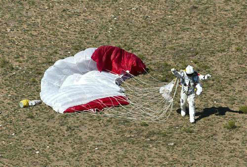 In this photo provided by Red Bull Stratos, pilot Felix Baumgartner of Austria lands in the desert after his successful jump on Sunday, Oct. 14, 2012 in Roswell, N.M. Baumgartner came down safely in the eastern New Mexico desert minutes about nine minutes after jumping from his capsule 128,097 feet, or roughly 24 miles, above Earth &#40;AP Photo&#47;Red Bull Stratos, Predrag Vuckovic&#41; <span class=meta>(Predrag Vuckovic&#47;Red Bull)</span>