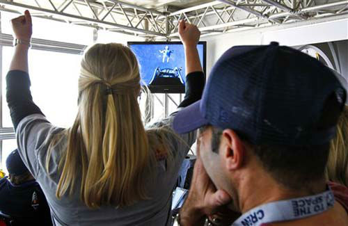 As project team members cheer on Felix Baumgartner, of Austria, he leaps out of the space capsule, as seen on television, at a height of just over 128,000 feet above the Earth&#39;s surface, Sunday, Oct. 14, 2012, in Roswell, N.M. Baumgartner came down safely in the eastern New Mexico desert minutes about nine minutes after jumping from his capsule 128,097 feet, or roughly 24 miles, above Earth.  &#40;AP Photo&#47;Ross D. Franklin&#41; <span class=meta>(Photo&#47;Ross Franklin)</span>