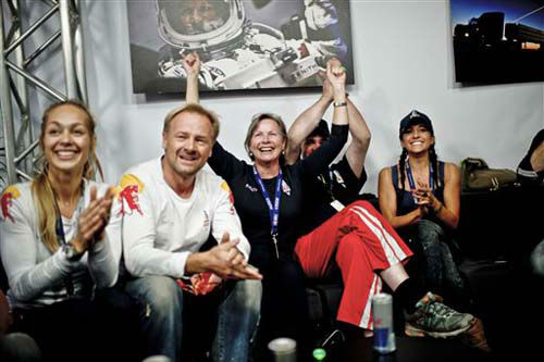 In this photo provided by Red Bull, family members and friends, celebrate the successful jump of pilot Felix Baumgartner of Austria in Roswell, N.M. on Sunday, Oct. 14, 2012. Baumgartner came down safely in the eastern New Mexico desert minutes about nine minutes after jumping from his capsule 128,097 feet, or roughly 24 miles, above Earth &#40;AP Photo&#47;Red Bull Stratos, Joerg Mitter&#41; MANDATORY CREDIT <span class=meta>(Photo&#47;Joerg Mitter)</span>