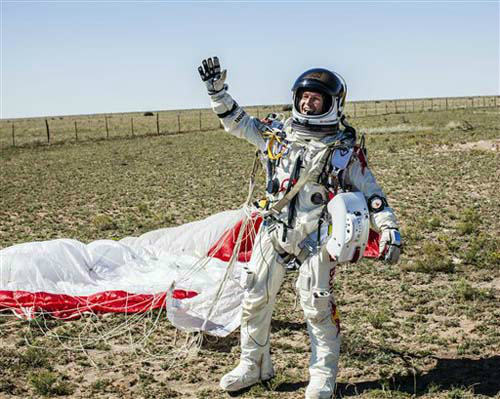 In this photo provided by Red Bull Stratos, Pilot Felix Baumgartner of Austria celebrates after successfully completing the final manned flight for Red Bull Stratos in Roswell, N.M., Sunday, Oct. 14, 2012. Baumgartner came down safely in the eastern New Mexico desert minutes about nine minutes after jumping from his capsule 128,097 feet, or roughly 24 miles, above Earth. &#40;AP Photo&#47;Red Bull Stratos, Balazs Gardi&#41; <span class=meta>(Photo&#47;Balazs Gardi)</span>