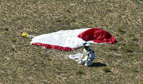 "<div class=""meta image-caption""><div class=""origin-logo origin-image ""><span></span></div><span class=""caption-text"">In this photo provided by Red Bull Stratos, pilot Felix Baumgartner of Austria lands in the desert after his successful jump on Sunday, Oct. 14, 2012 in Roswell, N.M. Baumgartner came down safely in the eastern New Mexico desert minutes about nine minutes after jumping from his capsule 128,097 feet, or roughly 24 miles, above Earth (AP Photo/Red Bull Stratos, Predrag Vuckovic) (Predrag Vuckovic/Red Bull)</span></div>"