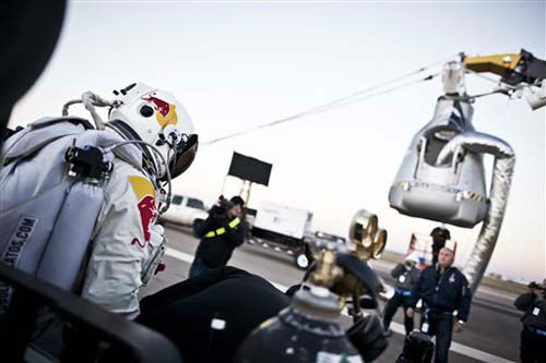 In this photo provided by Red Bull, Pilot Felix Baumgartner of Austria steps out from his trailer during the final manned flight for Red Bull Stratos in Roswell, N.M. on Sunday, Oct. 14, 2012.  Baumgartner plans to jump from an altitude of 120,000 feet, an altitude chosen to enable him to achieve Mach 1 in free fall, which would deliver scientific data to the aerospace community about human survival from high altitudes.&#40;AP Photo&#47;Red Bull Stratos, Balazs Gardi&#41; <span class=meta>(Photo&#47;Balazs Gardi)</span>