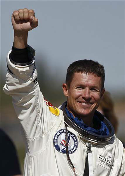 Felix Baumgartner, of Austria, pumps his fist to the crowd after successfully jumping from a space capsule lifted by a helium balloon at a height of just over 128,000 feet above the Earth&#39;s surface, Sunday, Oct. 14, 2012, in Roswell, N.M. Baumgartner came down safely in the eastern New Mexico desert minutes about nine minutes after jumping from his capsule 128,097 feet, or roughly 24 miles, above Earth &#40;AP Photo&#47;Ross D. Franklin&#41; <span class=meta>(Photo&#47;Ross Franklin)</span>