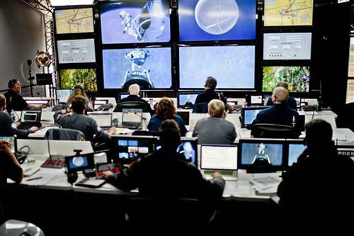 "<div class=""meta image-caption""><div class=""origin-logo origin-image ""><span></span></div><span class=""caption-text"">In this photo provided by Red Bull, crew members at the mission control watch the jump of pilot Felix Baumgartner of Austria in Roswell, N.M. on Sunday, Oct. 14, 2012. Baumgartner came down safely in the eastern New Mexico desert minutes about nine minutes after jumping from his capsule 128,097 feet, or roughly 24 miles, above Earth (AP Photo/Red Bull Stratos, Joerg Mitter) (Photo/Joerg Mitter)</span></div>"
