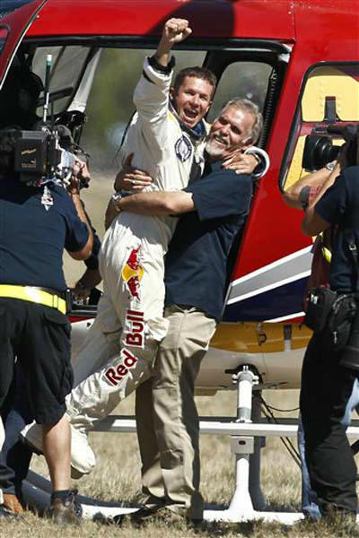 Felix Baumgartner, left, of Austria, celebrates with Art Thompson, Technical Project Director, after successfully jumping from a space capsule lifted by a helium balloon at a height of just over 128,000 feet above the Earth&#39;s surface, Sunday, Oct. 14, 2012, in Roswell, N.M.  Baumgartner landed in the eastern New Mexico desert minutes after jumping from his capsule 28,000 feet &#40;8,534 meters&#41;, or 24 miles &#40;38.6-kilometer&#41;, above Earth &#40;AP Photo&#47;Ross D. Franklin&#41; <span class=meta>(Photo&#47;Ross Franklin)</span>