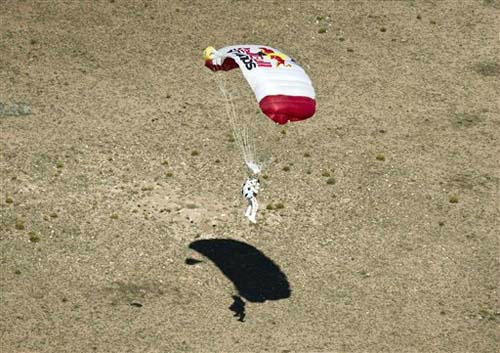 In this photo provided by Red Bull, pilot Felix Baumgartner of Austria lands in the desert after his successful jump on Sunday, Oct. 14, 2012 in Roswell, N.M. Baumgartner came down safely in the eastern New Mexico desert minutes about nine minutes after jumping from his capsule 128,097 feet, or roughly 24 miles, above Earth &#40;AP Photo&#47;Red Bull Stratos, Predrag Vuckovic&#41; MANDATORY CREDIT <span class=meta>(Photo&#47;Predrag Vuckovic)</span>